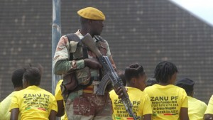 A soldier stands guard while waiting for Zimbabwean President Robert Mugabe to arrive for a crucial Zanu PF Poltiburo meeting in Harare, Wednesday Feb, 10, 2016. (AP Photo/Tsvangirayi Mukwazhi)