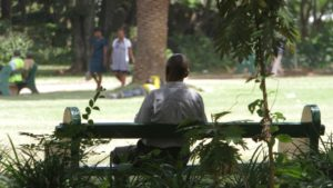 A man sits on a bench in a park in Harare, Zimbabwe, March 26, 2014. Zimbabwe has taken a new approach to addressing mental health issues by installing 'friendship benches' for counseling sessions.