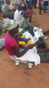 A teenage mother in Nkayi waiting to be given relief food by ACCZ officials.