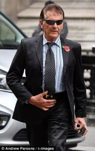 Nicholas van Hoogstraten, pictured outside the High Court, is being sued by the widow of a man whose killing a judge found he was involved in