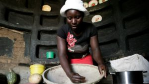 A woman prepares sorghum for food at her home in drought-hit Masvingo, Zimbabwe, June 1,2016.